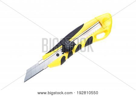 Photo of clerical knife close-up on white empty background