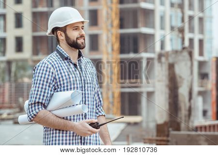 Male work building construction engineering occupation carry blueprint