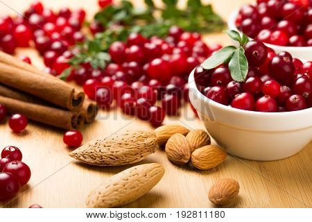 Ripe bowl berries cranberries almonds red berries sticks and red berries