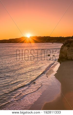 A view of a Praia da Rocha in Portimao during sunset Algarve region Portugal