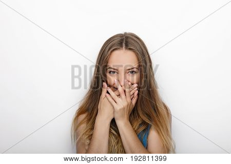 Headshot Of Young Adorable Blonde Woman Covers Her Mouth On White Background