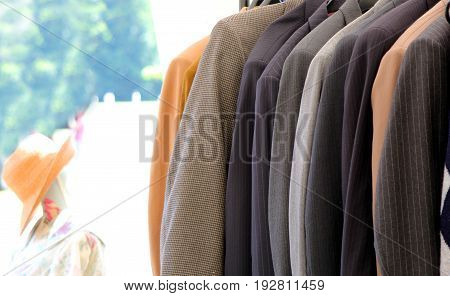 Shallow Focus Image Of A Selection Of Classic Men's Jackets And Blazers