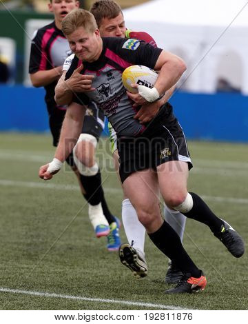 ST. PETERSBURG, RUSSIA - MAY 27, 2017: Match RC Livonia, Latvia (black trousers) vs RC Baltrex Siauliai, Lithiania during Rugby Europe Sevens Club Champion's Trophy. The city hosts trophy in 2nd time