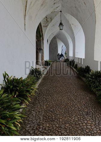 SINTRA, PORTUGAL - MAY 10, 2017: People in the gallery of National Palace of Sintra. Since 1995, the cultural landscape of Sintra is listed as UNESCO World Heritage