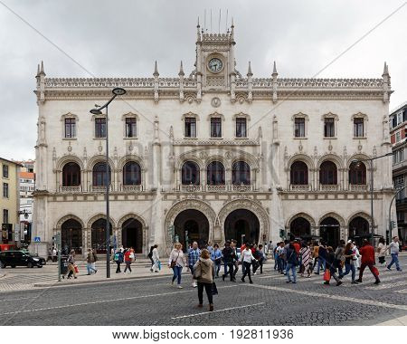 LISBON, PORTUGAL - MAY 9, 2017: People in front of the entrance to Rossio train station. Former central railway station, it was opened in 1891 and connected the city with the region of Sintra
