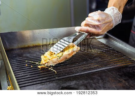 salmon roasted close up on home electronic grill plate tasty diet fish meal.