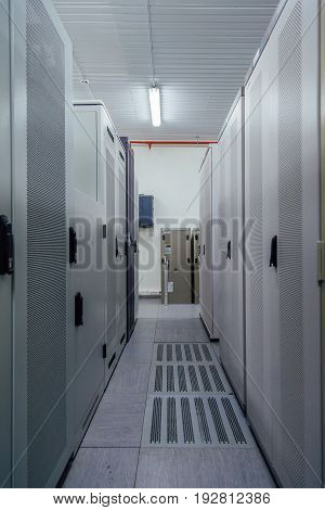 Switchgear room with cabinets with network hardware