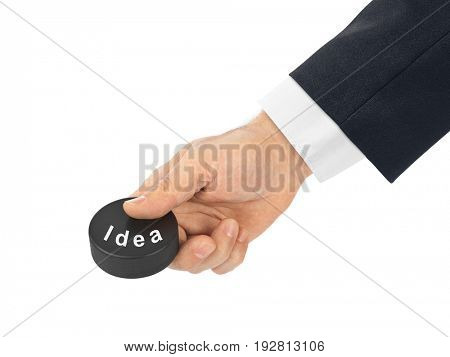Hand with hockey puck Idea isolated on white background