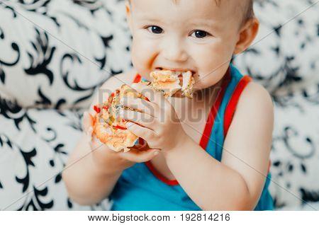 The Boy Eats A Piece Of Delicious Pizza