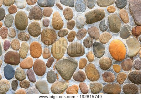Pebble stone rock texture and seamless background.