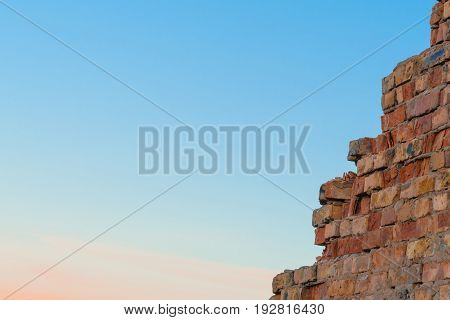 A Wall Of Burnt Brick With Lots Of Sky In The Frame