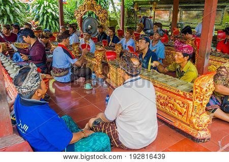 BALI, INDONESIA - APRIL 05, 2017:Unidentified people resting inside of a building in the beautiful temple in Ubud Bali located in Indonesia.