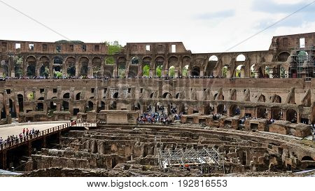 Rome, Italy - April 7, 2017 : People are visiting Colosseum. Colosseum the most well-known and remarkable landmark of Rome and Italy.
