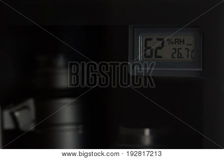 Display show humidity  in photography cabinet storage. Close-up of digital display