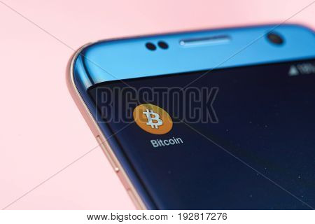 New york, USA - June 26, 2017: Bitcoin icon on mobile screen close-up. Internet money wallet on mobile device
