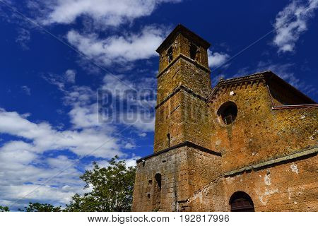 Medieval Chiesa di San Giovenale with clouds one of the most ancient churches in the historic center of Orvieto in Umbria Italy