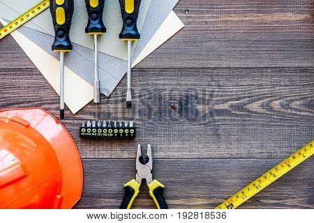 Reparing home concept. Tools on wooden desk background top view.