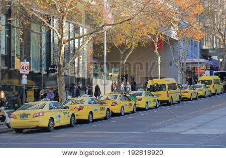 MELBOURNE AUSTRALIA - JUNE 14, 2017: Taxis wait for passengers in downtown Melbourne.