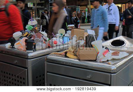 MELBOURNE AUSTRALIA - JUNE 14, 2017: Overflown public rubbish bin in downtown Melbourne
