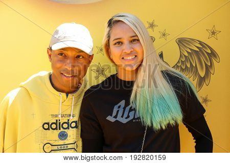 LOS ANGELES - JUN 24:  Pharrell Williams, Helen Lasichanh at the