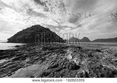 EL NIDO, PALAWAN, PHILIPPINES - MARCH 29, 2017: Black and White picture of the rocks at Las Cabanas Beach