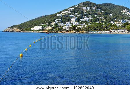 a panoramic view of the coastline and the Santa Eularia Beach in Santa Eularia des Riu, in Ibiza Island, Spain