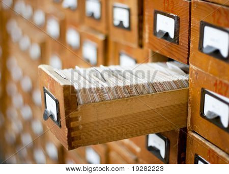 Old wooden card catalog with one opened drawer
