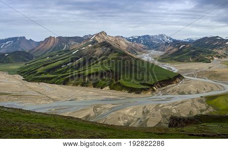 High colorful mountain ridge  with a flowing river in valley view from summit of Blahnakur mountain, Landmannalaugar, Iceland