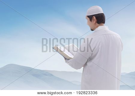Portrait Of Asian Muslim Man With Holy Book Koran
