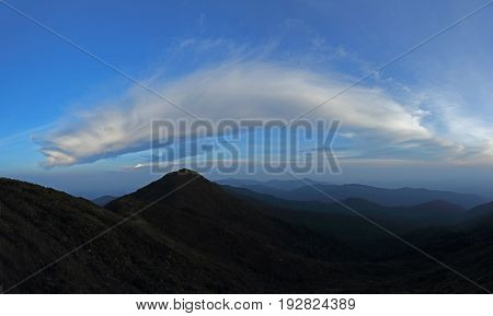 mountain range tropical rainforest canopy at southern of Thailand with more cloud background blue sky
