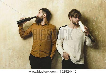 Men Or Bearded Friends Drinking From Bottles