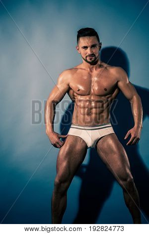 Athlete With Muscular Body In Underwear Pants