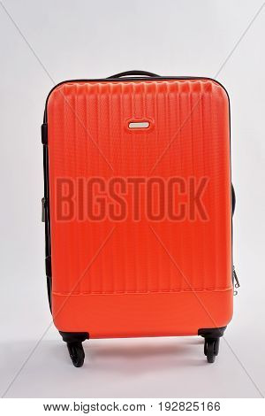 Bright suitcase for journey isolated. Red valise isolated on white.