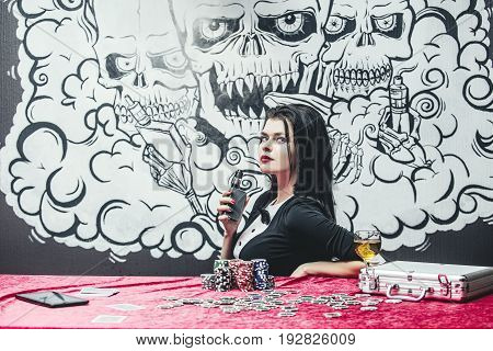 Woman Beautiful Young Successful Gambling In A Casino At A Table With Cards, Chips And Alcohol