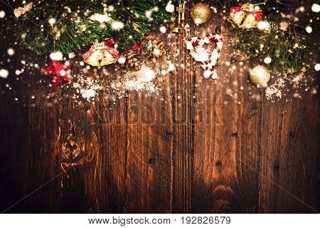 Christmas background with decorations on wooden board. vintage styles.