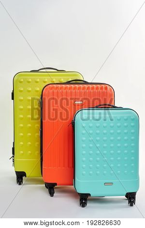 Set of different summer suitcases. Colorful luggages, front view.