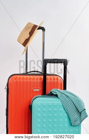 Suitcases and clothes for journey. Summer accessories for travelling abroad.