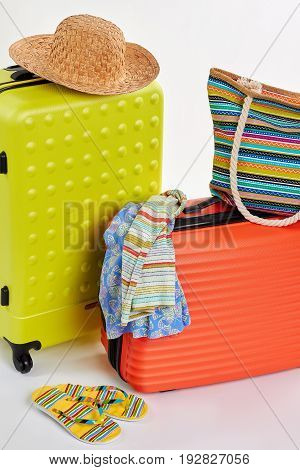 Suitcases and clothes for holiday. Family rest in colorful gamma.
