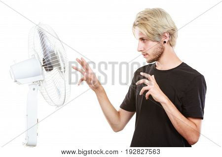 Young Man In Front Of Cooling Fan