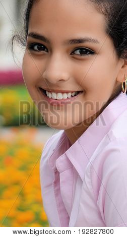 Beautiful Hispanic Girl Wearing a Pink Shirt