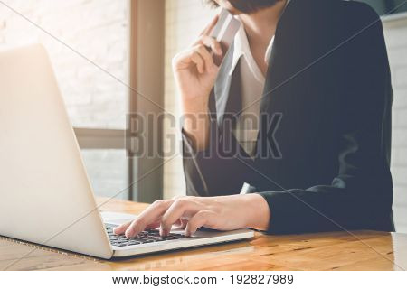 Online Payment,business Woman's Hands Holding A Credit Card And Using Laptop Computer For Online Sho