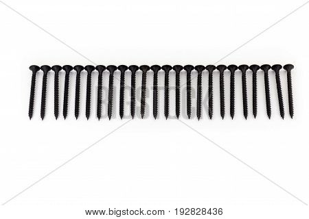 A raw of avarage black Oxidized self-tapping screws isolated on white background