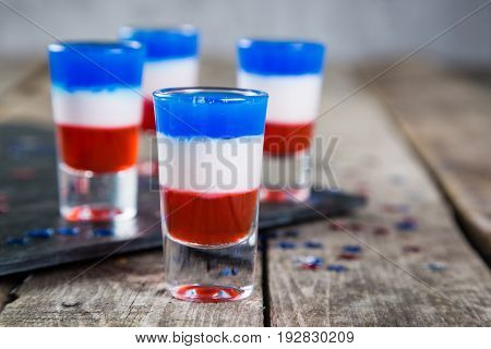 Independence day concept - flag coloured short cocktails on rustic background, copy space
