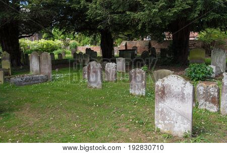 Churchyard with traditional catholic British cemetery with gravestones