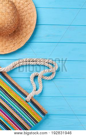 Woven hat, handbag, vertical image. Straw headgear and female beach bag, vintage background.