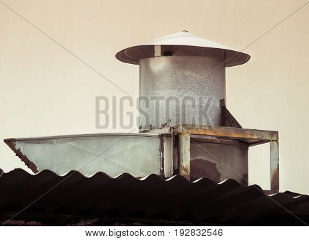 Smokestack for smoke out from kitchen. Chimney on roof