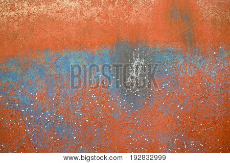 bold orange textured background with corrosive stain on metal surface