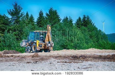 yellow bulldozer a moving land shovel. A close up