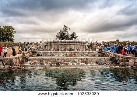 Copenhagen Denmark - August 10 2016. The Gefion Fountain is a large fountain in Copenhagen view with a crowd of tourist a cloudy day of summer. It is located in Langelinie Park is the largest monument in Copenhagen.