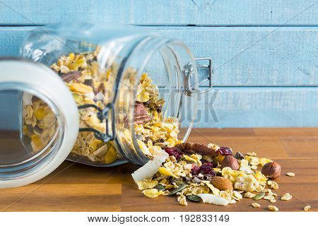 Tasty homemade muesli with nuts in jar.